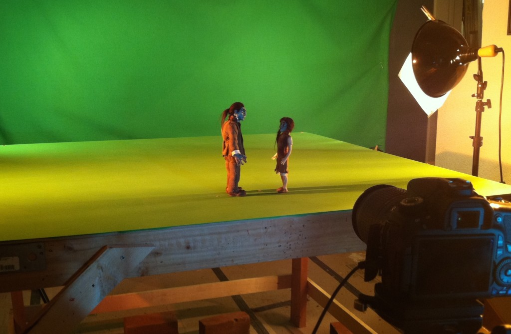 Frank and the Zombie Girl in front of a green screen.